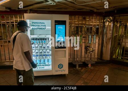 A vending machine in the Herald Square subway station in New York on Tuesday, June 30, 2020 sells PPE merchandise to riders. The MTA has placed twelve vending machines selling personal protective equipment and hand sanitizer in 10 major stations in the system. Masks are required to ride subways and busses. © Richard B. Levine) - Stock Photo