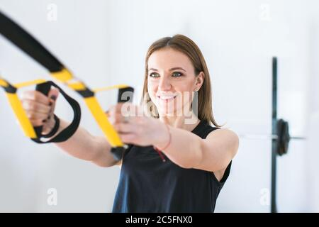 portrait of young woman exercising at the gym