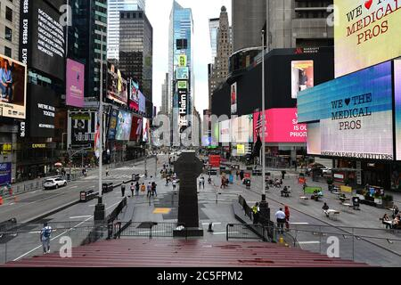 "New York City, USA. 30th June, 2020. Normally bustling with tourists and visitors, the red ""TKTS"" steps at Duffy Square in Times Square are closed to the general public to prevent people from being close together in the time of the COVID-19 pandemic, New York, NY, June 30, 2020. Announced by the Broadway League, Broadway shows and performances have been closed down through the end of 2020, due to the worldwide COVID-19 pandemic. (Anthony Behar/Sipa USA) Credit: Sipa USA/Alamy Live News - Stock Photo"