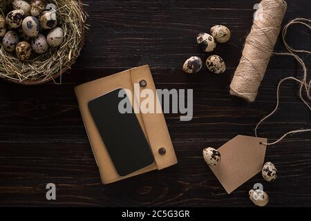 quail eggs in a nest, place for text on wooden rustic background top view close up Stock Photo