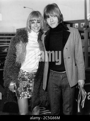 Dec. 3, 1966 - London, England, U.K. - Rolling Stones guitarist BRIAN JONES with girlfriend ANITA PALLENBERG at Heathrow Airport.  (Credit Image: © Keystone Press Agency/Keystone USA via ZUMAPRESS.com) - Stock Photo