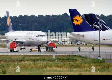 02 July 2020, Brandenburg, Schönefeld: An Airbus A320-200 of the airline Lufthansa is parked at the edge of the tarmac. Photo: Soeren Stache/dpa-Zentralbild/ZB - Stock Photo