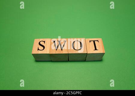 The word swot made from wooden cubes. Work and business concept. - Stock Photo