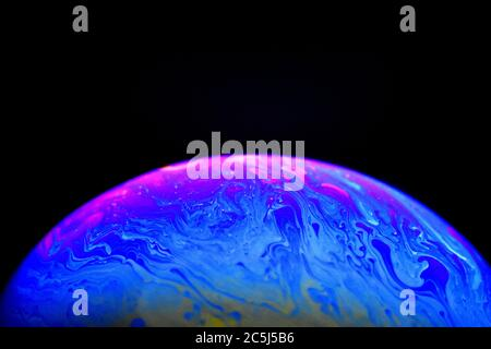 Close up view of color pattern on soap bubble surface. atmospher and planet model. - Stock Photo