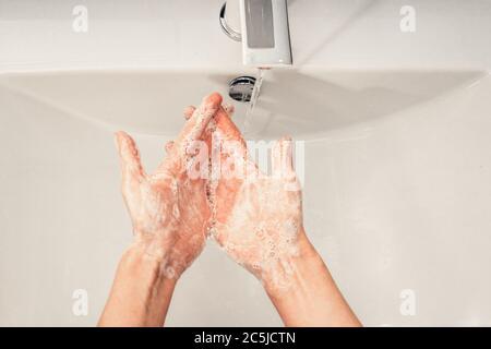 Coronavirus. Proper washing and handling of hands. Liquid antibacterial soap. Self-isolation and hygiene.