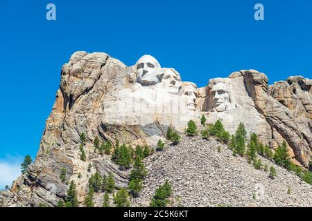 Wide angle view of Mount Rushmore national monument with surrounding forest and nature near Rapid City in South Dakota, United States of America, USA. - Stock Photo