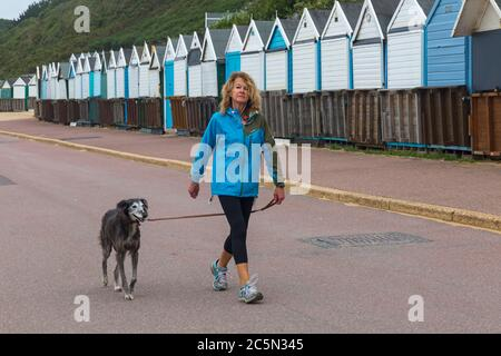Bournemouth, Dorset UK. 4th July 2020. UK weather: windy, drizzly and murky at Bournemouth beaches as very few people visit the seaside, apart from surfers and kite surfers, so can adhere to social distancing measures. Credit: Carolyn Jenkins/Alamy Live News - Stock Photo