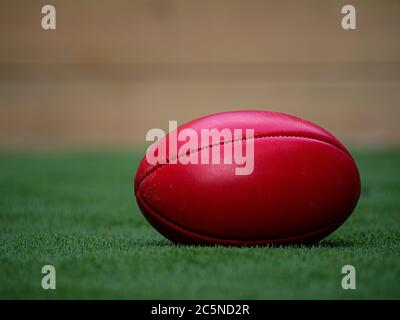 A Football on a Field all by itself, isolation