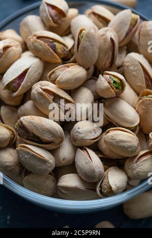 Roasted And Salted Pistachios In Glass Bowl - Stock Photo