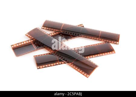 strips of 35 millimeter exposed film negative isolated on white - Stock Photo