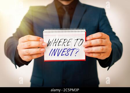 Writing note showing Where To Invest Question. Business concept for fundraising money to start business project startup Model displaying different emp - Stock Photo