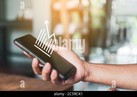 Market stock graph icon screen of smartphone background. Financial business technology freedom dream life using internet freedom life concept. - Stock Photo