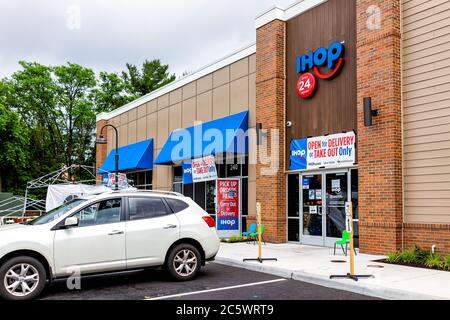 Herndon, USA - June 11, 2020: Virginia Fairfax County street with sign for open ihop restaurant for take-out and delivery during coronavirus - Stock Photo
