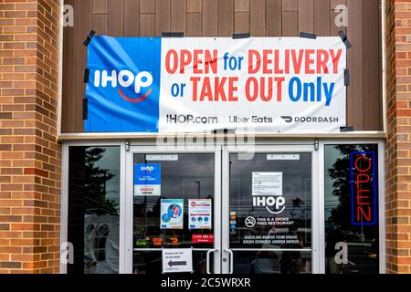 Herndon, USA - June 11, 2020: Virginia Fairfax County building entrance sign for open ihop restaurant for take-out and delivery during coronavirus - Stock Photo