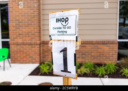 Herndon, USA - June 11, 2020: Virginia Fairfax County closeup of parking spot sign for open ihop restaurant for take-out and delivery during coronavir - Stock Photo