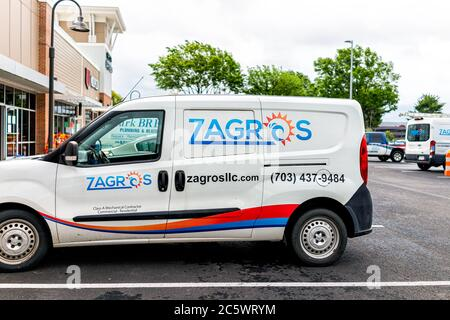 Herndon, USA - June 11, 2020: Virginia Fairfax County strip mall plaza centre with sign on car van for Zagros Heating & Air Conditioning - Stock Photo