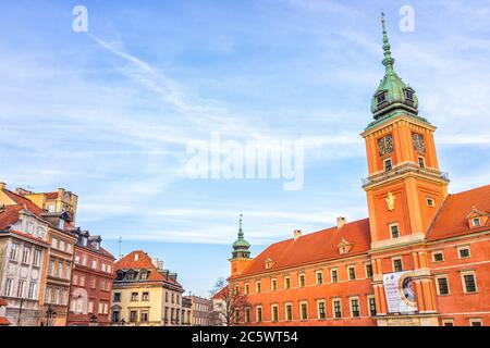 Warsaw, Poland - December 19, 2019: Old town Warszawa Christmas historic famous Castle Square with red building in capital city during winter sunset a Stock Photo