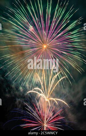 Fireworks over Missouri Southern State University in Joplin, Missouri on July 4, 2020 - Stock Photo