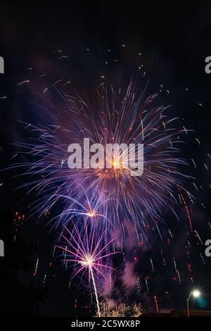 Fireworks over Missouri Southern State University in Joplin, Missouri on July 4, 2020 - Stock Photo