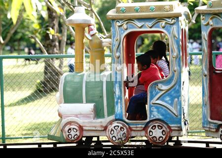 Colombo, Sri Lanka. 5th June, 2020. Children have fun on a children's train in Viharamahadevi Park in Colombo, Sri Lanka, June 5, 2020. The Viharamahadevi Park has attracted many citizens during the weekend. All national parks, zoo's and botanical gardens in Sri Lanka reopened to public on June 15 after being shut since late March due to the COVID-19 pandemic. Credit: Tang Lu/Xinhua/Alamy Live News - Stock Photo