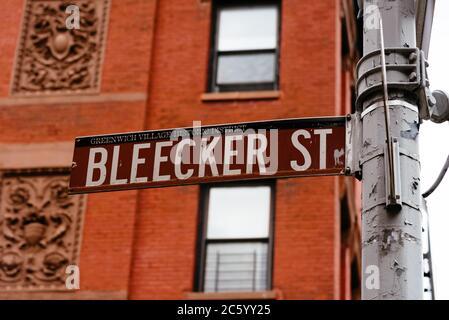 Bleecker Street road sign in Greenwich VIllage in New York City. - Stock Photo