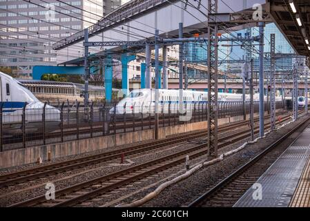 At the train station in Tokyo, Japan, where the train is coming in, - Stock Photo