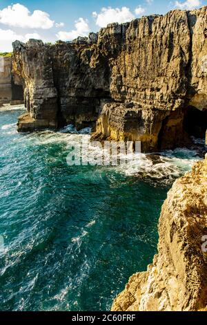Hell's Mouth (Boca do Inferno in Portuguese) is a chasm located in the seaside cliffs close to the Portuguese city of Cascais. - Stock Photo