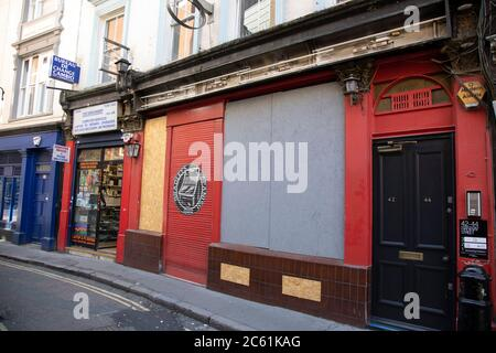 Bradleys Spanish Bar boarded up with its signs taken down as the Coronavirus lockdown measures are set to ease further and the quiet city starts coming to an end on 22nd June 2020 in London, England, United Kingdom. As of today the government has relaxed its lockdown rules, and is allowing some non-essential shops to open with individual shops setting up social distancing queueing systems. - Stock Photo