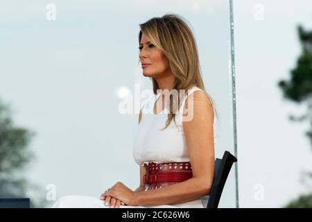 U.S. First Lady Melania Trump listens to remarks by  President Donald Trump at the annual Independence Day celebration on the South Lawn of the White House July 4, 2020 in Washington, DC. - Stock Photo