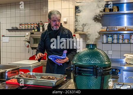 German  3 Michelin star chef Marco Müller with Big Green Egg. One of the secrets of tender beef brisket is the 'reverse' order: first heat it in the oven at low heat and then grill it hot in its own smoke just before cutting it