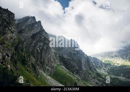 Scenic view of sharp rocky mountain peaks in the dark clouds near the Morskie Oko lake, High Tatras, Zakopane, Poland - Stock Photo