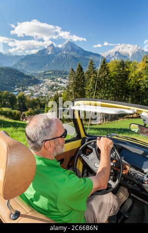 On the road in the vintage VW Beetle Cabrio above Berchtesgaden behind the Watzmann, Berchtesgadener Land, Upper Bavaria, Bavaria, Southern Germany, Germany, Europe - Stock Photo