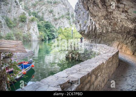 At Matka Canyon,near Skopje visitors can walk the pathway running next to the river and the waters of Matka lake. - Stock Photo