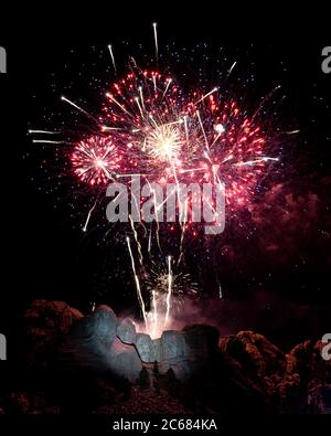 Fireworks explode over the colossal sculpture faces at Mount Rushmore National Memorial during the Salute to America Independence Day celebration July 3, 2020 in Keystone, South Dakota. - Stock Photo