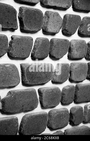 Irregular brick arrangement. On the wall. In black and white. - Stock Photo
