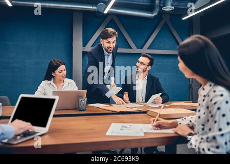Relaxed informal IT business startup company meeting - Stock Photo