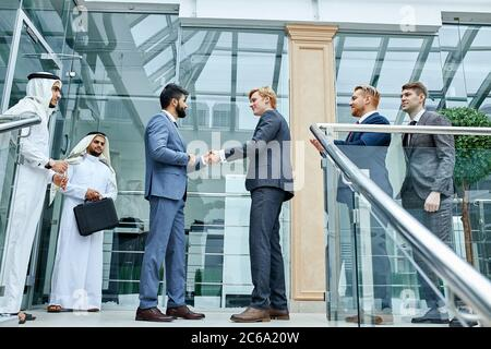 Successfully made deal between sheikh and caucasian businessman. Business, money deal - Stock Photo