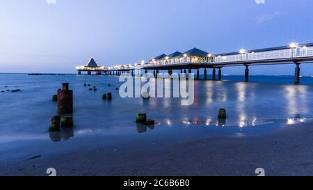 pier of Heringsdorf on island Usedom at night - Stock Photo