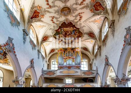 Laufenburg, AG / Switzerland - 4 July 2020: interior view of the St. Johann church in Laufenburg with the organ and ceiling paintings