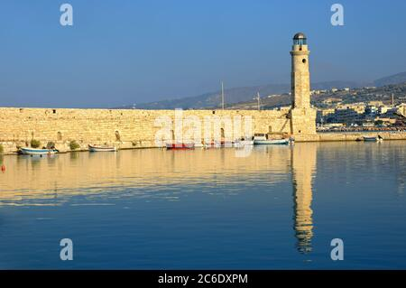 A panoramic view on the harbor at Rethymnon on the Greek isle of Crete. Marina and old fortress wall and lighthouse - Stock Photo