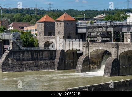 Laufenburg, AG / Switzerland - 4 July 2020: historic hydroelectric power plant on the Rhine River in Laufenburg