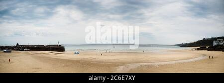 Panorama of Beach in St. Ives at low tide in Cornwall in England.