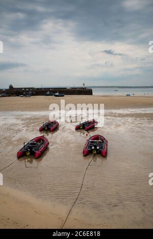 View of boats in St. Ives beach at low tide in Cornwall in England