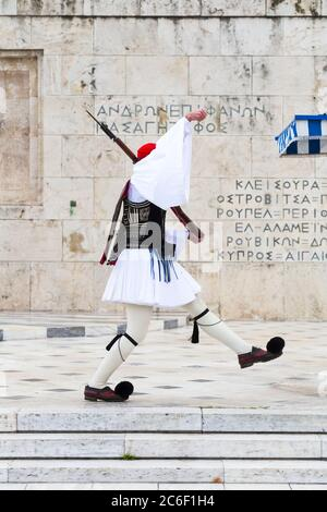 Evzones guarding the Tomb of the Unknown Soldier in Athens, Greece. Greek soldier Evzones dressed in traditional uniforms, refers to the members of th