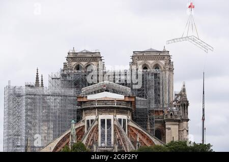 Paris, France. 15th Apr, 2019. File photo taken on June 9, 2020 shows the Notre Dame de Paris cathedral under repair after it was badly damaged by a huge fire on April 15, 2019. 'A broad consensus' has been reached to rebuild the spire of the Notre-Dame Cathedral in the French capital as it was before the blaze in April last year, Minister of Culture Roselyne Bachelot told France Inter radio on Thursday, adding that the final decision belongs to President Emmanuel Macron. Credit: Gao Jing/Xinhua/Alamy Live News - Stock Photo