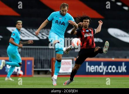 Tottenham Hotspur's Harry Kane (left) and Bournemouth's Nathan Ake battle for the ball during the Premier League match at Vitality Stadium, Bournemouth. - Stock Photo