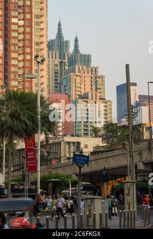 Bangkok, Thailand - January 14th, 2019: Twilight view to Bangkok skyscrapers shining in the late sun around Ratchaprarop Road at Ratchathewi District. - Stock Photo