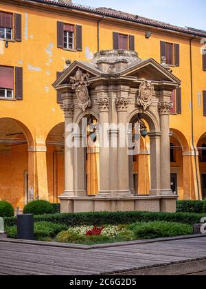 Pozzo dei desideri. Wishing well in the courtyard of Palazzo Comunale. Bologna, Italy. - Stock Photo