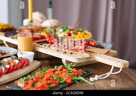 tasty and healthy food lies on  table, fish and vegetables are beautifully sliced, beautiful dishes on  wooden table, selective focus