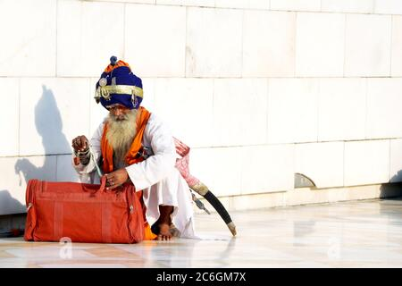 Amritsar, India - December 03, 2019: Unidentified Sikh man visiting the Golden Temple in Amritsar, Punjab, India. Sikh pilgrims travel from all over I - Stock Photo